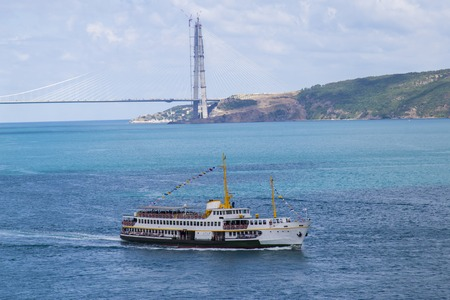 City ferry of Istanbul during the Bosphorus Tour with background of third bridge of bosphorus