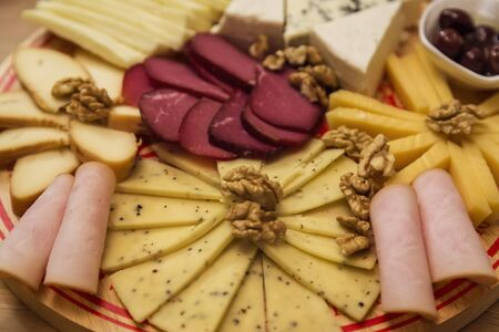 cheeseboard: Cheese Board over Wooden Table With smoked meat Stock Photo