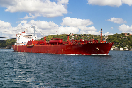 Big size commercial ship view from Istanbul Bosphorus with blue sky