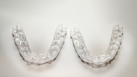 Isolated transparent teeth prosthesis over white for deisgn Фото со стока