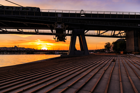 Silhouette view of Istanbul metro bridge during the sunset with reverse light Stock Photo