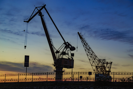 Silhouette view of dock crane with reverse light Stock Photo