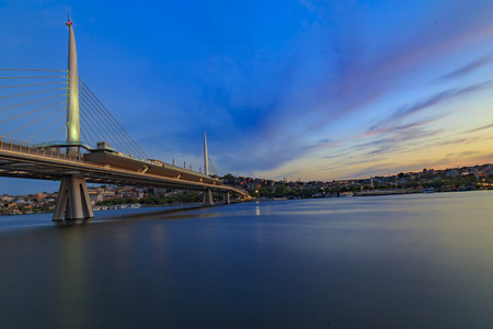 Istanbul new built Halic metro bridge during the twilight with its post modern look