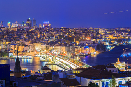 Istanbul view from down town of the city during the twilight with beatiful atmospheric blue sky and city lights Stock Photo