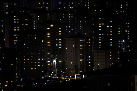 Massive aparments view during the night time with its electric lights Stock Photo