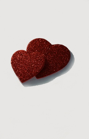 two dark red hearts on white background photo