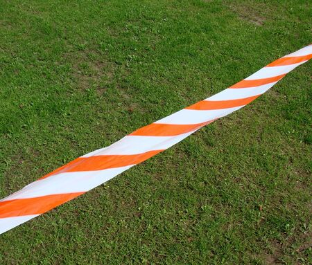 demarcation: warning using label with ribbon Stock Photo