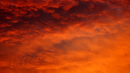 dark red and orange clouds in the sky during the sunset photo