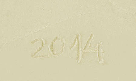 year 2014 and sand on the beach Stock Photo - 21786444