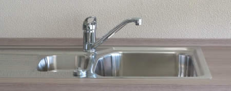 beautiful modern kitchen sink and faucet from metal photo