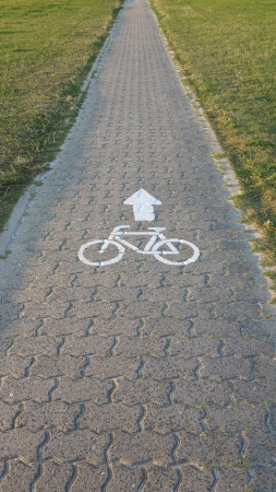 cycle route with a traffic sign on the dyke Stock fotó