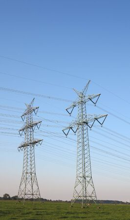 two high voltage towers and power lines photo