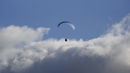 Paragliding over the clouds photo