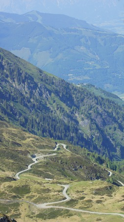 beautiful little serpentine road high in the mountains in summer photo