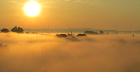beautiful sunrise and covered by fog landscape photo