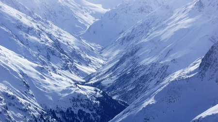 beautiful mountains and valleys in winter and lots of snow photo