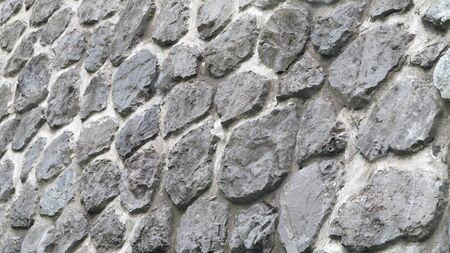 beautiful wall of gray round stones
