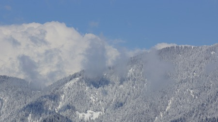 The first snow in the mountains and beautiful clouds Stock fotó