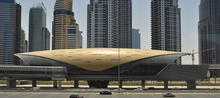 Metro station in Dubai Downtown, with tower in background photo