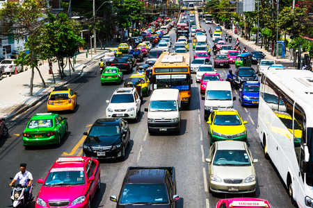 CO2 emissions: BANGKOK, THAILAND - March 13, 2016: Traffic moves slowly along a busy road in Bangkok, Thailand.