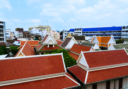 wat traimit: View of colorful oriental rooftops from Wat Traimit temple Bangkok, Thailand. Selective focus Stock Photo