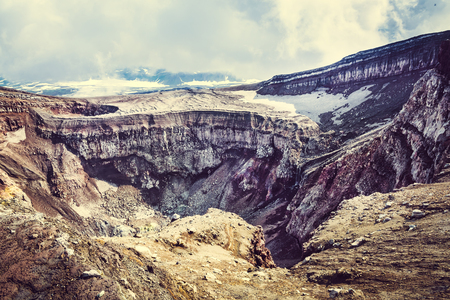 slag: Crater of the volcano Goreliy on Kamchatka, Russia. Selective focus, toned