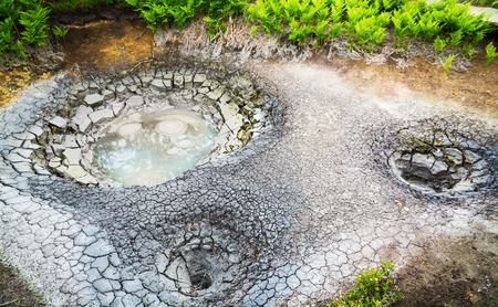 Mud cauldron in legendary Valley of Geysers. Kamchatka, Russia. Selective focus