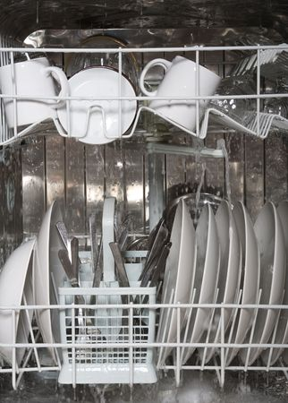 wash dishes: Inside of dishwasher Stock Photo