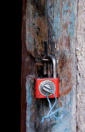 Old padlock on a wooden door Stock Photo - 3009599