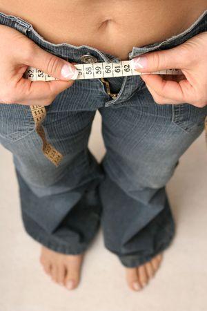 weightless: measuring waist Stock Photo
