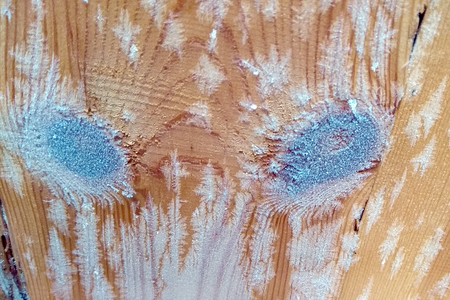 crystals of snowflakes on wooden boards closeup