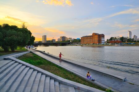The embankment of the Iset river in Yekaterinburg in the evening at sunset