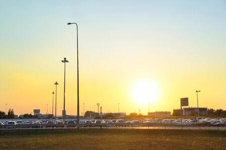 guarded: Car Parking at the airport Koltsovo in Yekaterinburg and a parked car at sunset Stock Photo