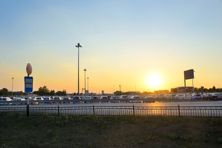 Car Parking at the airport Koltsovo in Yekaterinburg and a parked car at sunset Stock Photo