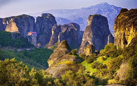 Meteora - Greece is a big monastery complex including nine reserved monastery built on top of difficult high cliffs resembling stone pillars 400 meters.