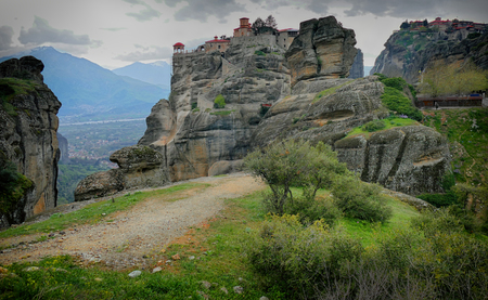 Meteora is a big monastery complex including nine reserved monastery built on top of difficult high cliffs resembling stone pillars. Stock Photo