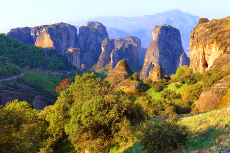 Greece, Meteora - a natural phenomenon of rocks resembling stone columns reaching 400 meters. At the peaks there are 9 Christian monasteries. Stock Photo