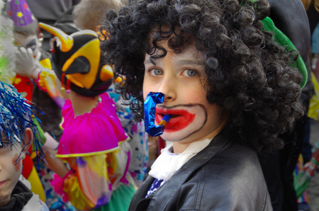 Young boy with whistle, participant in the carnival in Gabrovo, Bulgaria - May 17, 2014.
