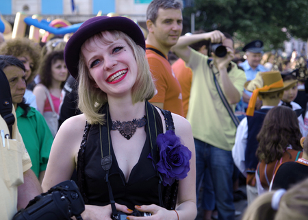 A smiling girl. Happy mood. Viewing a Carnival Procession in Gabrovo, Bulgaria - May 18, 2013. Redakční