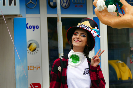 Gabrovo, Bulgaria May 19, 2018. Traditional Carnival of Humor and Satire. Street art. Woman with funny hat and makeup posing for a photo. Redakční