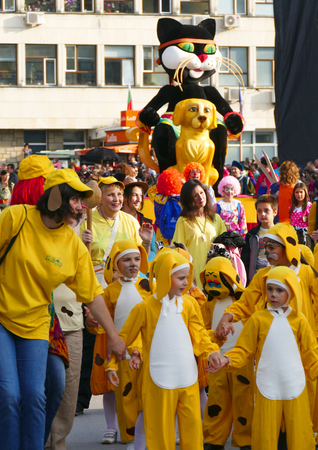 Gabrovo, Bulgaria May 19, 2018. Traditional Carnival of Humor and Satire. Street art. A group of children dressed as a yellow dog. Redakční