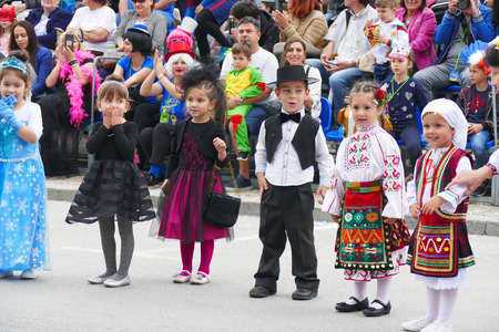 Gabrovo, Bulgaria May 19, 2018. Traditional Carnival of Humor and Satire. Street art. A group of children dressed in different costumes. Redakční