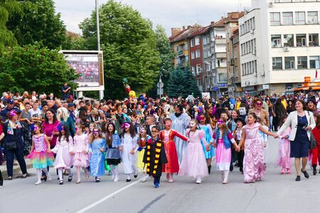 Gabrovo, Bulgaria May 19, 2018. Traditional Carnival of Humor and Satire. Street art. A group of children costume of fairy tales pass the carnival with their teachers..