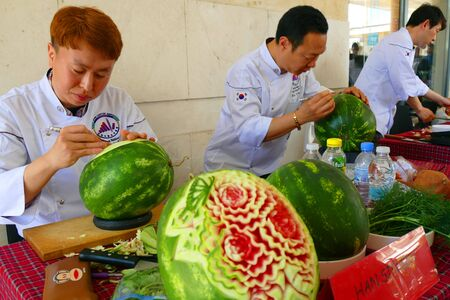 Gabrovo, Bulgaria May 20, 2018. Traditional Carnival of Humor and Satire. Street art. International Carving Festival. South Korean youth carve watermelon.