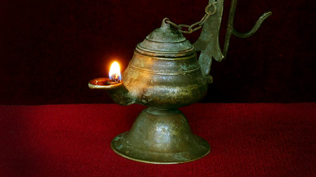 Illuminated antique lamp. Antique bronze thurible with oil. Reklamní fotografie - 110010515