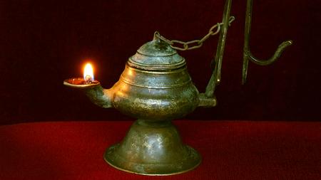 Illuminated antique lamp. Antique bronze thurible with oil. Reklamní fotografie