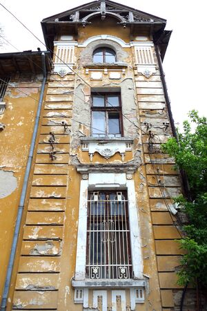 An old ruinous building. Modern architecture from the early 20th century. Redakční