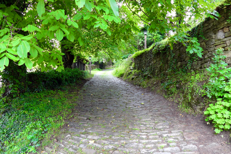Stone path. Ancient rural architecture from the 18th century. The village is an architectural reserve.