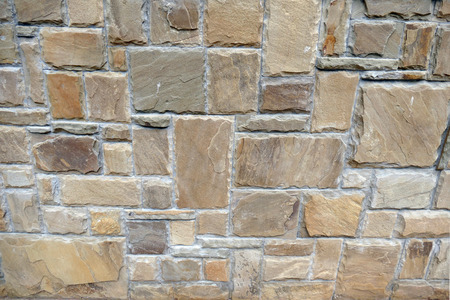 A wall lined with natural stone.