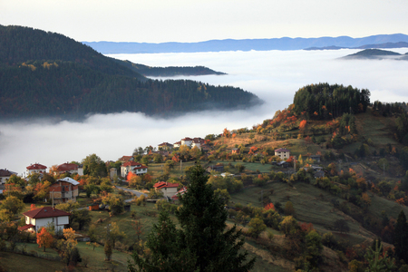 Autumn in the Rhodope Mountains, Bulgaria. Early morning. The mountain is covered with fog. Фото со стока
